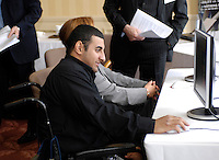 Queens Club, GREAT BRITAIN,  Powerlifting Ali JAWAD, check's out the web-site, after the  press Conference to announce the joint initiative between British Paralympic Association and Deloitte  of 'www.Parasport.org.uk' online information service, on Thur's.  03.05.2007. London. [Credit: Peter Spurrier/Intersport Images]