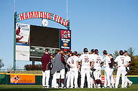 Members of the Missouri State Bears have a pregame meeting prior to a game against the Southern Illinois University- Edwardsville Cougars at Hammons Field on March 10, 2012 in Springfield, Missouri. (David Welker / Four Seam Images)