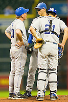 Kentucky Wildcats head coach Gary Henderson #20 has a chat with starting pitcher Taylor Rogers #34 and catcher Luke Maile #21 at Minute Maid Park on March 4, 2011 in Houston, Texas.  Photo by Brian Westerholt / Four Seam Images