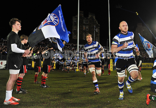 Dominic Day, Matt Garvey and the rest of the Bath Rugby team run out onto the field for the start of the match. Aviva Premiership match, between Bath Rugby and Sale Sharks on March 6, 2015 at the Recreation Ground in Bath, England. Photo by: Patrick Khachfe / Onside Images