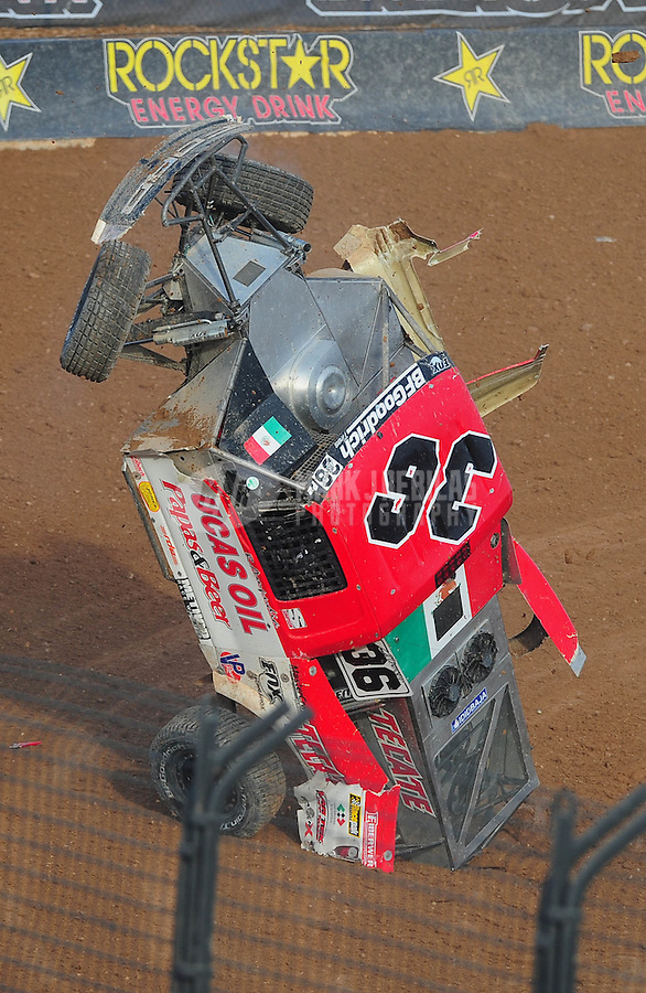 Dec. 11, 2011; Chandler, AZ, USA; LOORRS pro two unlimited driver Rodrigo Ampudia crashes during the Lucas Oil Challenge Cup at Firebird International Raceway. Mandatory Credit: Mark J. Rebilas-