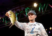 NWA Democrat-Gazette/BEN GOFF -- 04/25/15 Stetson Blaylock, FLW pro from Benton, displays one of his bass during weigh-in on day three of the Walmart FLW Tour at Beaver Lake on Saturday Apr. 25, 2015 at the John Q. Hammons Center in Rogers. Blaylock stood in third place with a three-day total of 37 lbs. 3 oz.