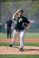 Pittsburgh Pirates starting pitcher Jake Barrett (90) delivers a pitch during a Minor League Spring Training game against the Philadelphia Phillies on March 13, 2019 at Pirate City in Bradenton, Florida.  (Mike Janes/Four Seam Images)