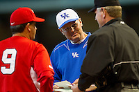 Kentucky Wildcats head coach Gary Henderson #20 meets with Houston Cougars head coach Todd Whitting #9 and home plate umpire Danny Mascorro at Minute Maid Park on March 5, 2011 in Houston, Texas.  Photo by Brian Westerholt / Four Seam Images