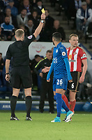 Referee Graham Scott give a yellow card to Lee Cattermole  of Sunderland during the Premier League match between Leicester City v Sunderland played at King Power Stadium, Leicester on 4th April 2017.<br /> <br /> <br /> available via IPS Photo Agency/Rex Features  only