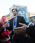 Nikolas Olsson (BU - 13) - The teams walked the red carpet through the Fan Fest outside TD Garden prior to the Frozen Four final on Saturday, April 11, 2015, in Boston, Massachusetts.