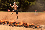 June 1, 2013. Huntersville, North Carolina<br />  A fire jump led contestants towards the final obstacle.<br />  A North Carolina chapter of The Warrior Dash, which consists of a 5k run/walk broken up by several obstacles, was held over the weekend with thousands turning out to test their abilities in a race against the clock and each other. Participants in all age groups were sent out in heats over the course of the entire day.
