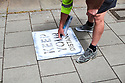 Painting Keep Your Distance markings on pavement in Oxford City Centre preparing for the non essential shops reopening on 15/6/20. CREDIT Geraint Lewis