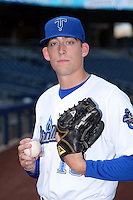 Tulsa Drillers pitcher Daniel Winkler (19) poses for a photo before a game against the Midland RockHounds on May 31, 2014 at ONEOK Field in Tulsa, Oklahoma.  Tulsa defeated Midland 5-3.  (Mike Janes/Four Seam Images)
