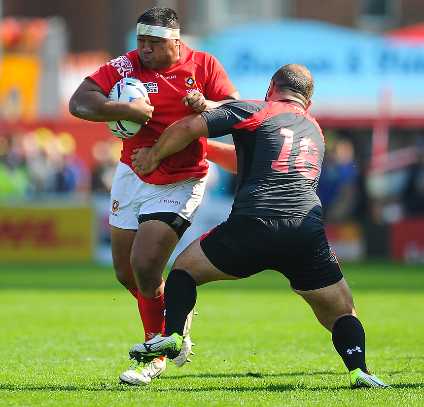 Tonga's Sila Puafisi is tackled by Georgia's Levan Chilachava<br /> <br /> Photographer Craig Thomas/CameraSport<br /> <br /> Rugby Union - 2015 Rugby World Cup - 12;00  Georgia v Tonga - Saturday 19th September 2015 - Kingsholm - Gloucester <br /> <br /> &copy; CameraSport - 43 Linden Ave. Countesthorpe. Leicester. England. LE8 5PG - Tel: +44 (0) 116 277 4147 - admin@camerasport.com - www.camerasport.com