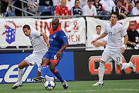 Frantz Bertin (6) of Haiti (HAI) and Davy Arnaud (22) of the United States (USA). The United States and Haiti played to a 2-2 tie during a CONCACAF Gold Cup Group B group stage match at Gillette Stadium in Foxborough, MA, on July 11, 2009. .