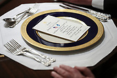 A place setting with a menu sits on a table in the Cabinet Room during a luncheon with United States President Donald J. Trump and the Permanent Representatives of the United Nations Security Council in the Cabinet Room of the White House on December 5, 2019 in Washington, DC.<br /> Credit: Oliver Contreras / Pool via CNP
