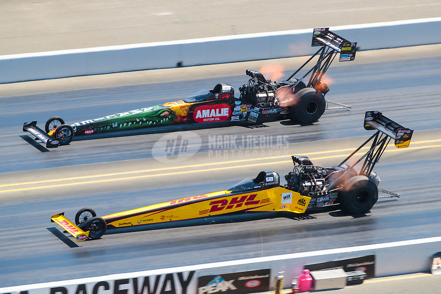Jul 28, 2019; Sonoma, CA, USA; NHRA top fuel driver Richie Crampton (near) races alongside Terry McMillen during the Sonoma Nationals at Sonoma Raceway. Mandatory Credit: Mark J. Rebilas-USA TODAY Sports