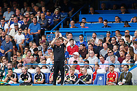 Sheffield United manager, Chris Wilder applauds the support during the Premier League match between Chelsea and Sheff United at Stamford Bridge, London, England on 31 August 2019. Photo by Carlton Myrie / PRiME Media Images.