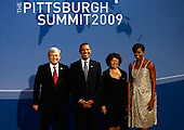 Pittsburgh, PA - September 24, 2009 -- United States President Barack Obama (2L) and U.S. first lady Michelle Obama (R) welcome Australian Prime Minister Kevin Rudd (L) and his wife Therese Rein to the opening dinner for G-20 leaders at the Phipps Conservatory on Thursday, September 24, 2009 in Pittsburgh, Pennsylvania. Heads of state from the world's leading economic powers arrived today for the two-day G-20 summit held at the David L. Lawrence Convention Center aimed at promoting economic growth.  .Credit: Win McNamee / Pool via CNP