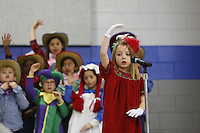 NWA Media/DAVID GOTTSCHALK - 12/16/14 - Christmas performance at Asbell Elementary School in Fayetteville performs with three first grade classes Tuesday December 16, 2014. The theme of the performance was Miss Popinger's Christmas under the direction of music teacher Carlena Lambert.