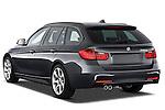 Rear three quarter view of a 2013 BMW 330d Touring Wagon