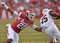 STAFF PHOTO BEN GOFF  @NWABenGoff -- 09/20/14 <br /> Arkansas defender Josh Liddell attempts to tackle Northern Illinois wide receiver Christian Blake during the second quarter of the game against Northern Illinois in Reynolds Razorback Stadium in Fayetteville on Saturday September 20, 2014.