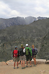 Hikers viewing the Continental Divide during a thunderstorm in Rocky Mountain National Park, west of Estes Park, Colorado.