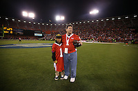 SAN FRANCISCO, CA - JULY 12:  Former San Francisco 49ers owner Eddie DeBartolo, Jr. stands at midfield clutching the game ball with his grandson Asher after the Legends of Candlestick flag football game at Candlestick Park in San Francisco, California on July 12, 2014. Photo by Brad Mangin