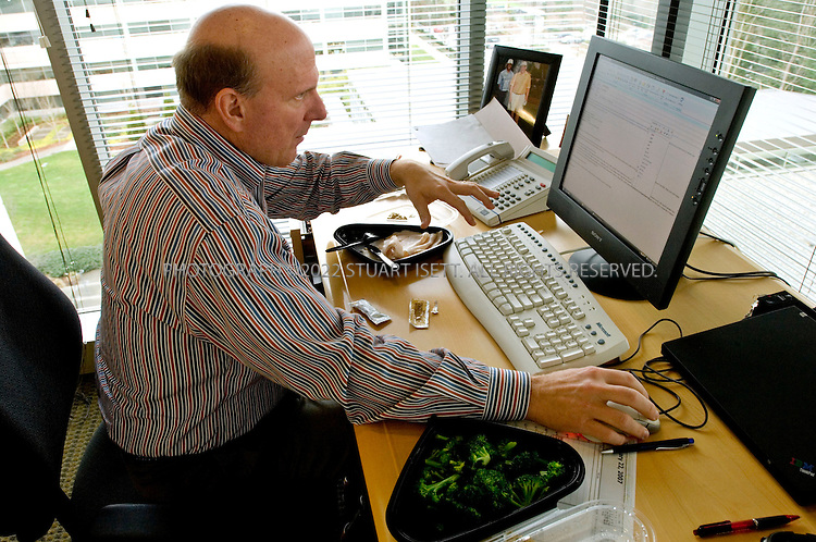 1/23/2007--Redmond, WA, USA..12:21pm: Steve Ballmer, CEO of Microsoft, takes a quick  lunch break at his desk while checking his email. When in the Microsoft office, Ballmer will usually eat food from Microsoft's cafeteria, sitting at his desk catching up on correspondence...Photograph ©2007 Stuart Isett.All rights reserved