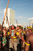 Indigenous warriors gather in front of the Congress building at a demonstration in Brasilia, Brazil by the Xicrin, Kayapo and Pataxo tribes, 10th November 2015. Photo © Sue Cunningham, pictures@scphotographic.com