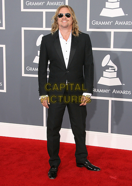 Val Kilmer.The 54th Annual GRAMMY Awards held at the Staples Center, Los Angeles, California, USA..February 12th, 2012.full length black suit white shirt sunglasses shades goatee facial hair .CAP/ADM.©AdMedia/Capital Pictures.