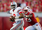 Wisconsin Badgers defensive lineman Louis Nzegwu (93) pressures Ohio State Buckeyes quarterback Terrelle Pryor (2) during an NCAA college football game on October 16, 2010 at Camp Randall Stadium in Madison, Wisconsin. The Badgers beat the Buckeyes 31-18. (Photo by David Stluka)