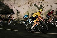 yellow jersey / GC leader Geraint Thomas (GBR/SKY) rolling through a huge dark cave: the 'Grotte du Mas-d'Azil'<br /> <br /> Stage 16: Carcassonne &gt; Bagn&egrave;res-de-Luchon (218km)<br /> <br /> 105th Tour de France 2018<br /> &copy;kramon