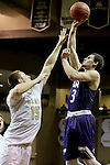 SIOUX FALLS, SD: Mack Johnson #3 from the University of Sioux Falls shoots over Joey Bartlett #15 from Southwest Minnesota State in the first half of their NSIC Tournament game Sunday at the Sanford Pentagon (Photo by Dave Eggen/Inertia)
