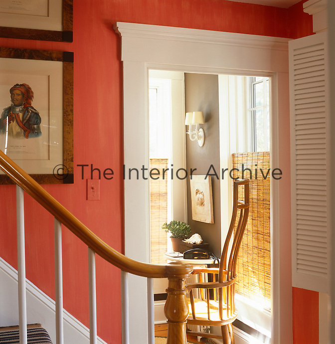 Glimpse over the stair banister into a room beyond the hallway