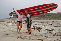 "Tom Jones is greeted by Jericho Poppler after he arrived at the US Mexico border at Border Field State Park, the south-western most corner of the contiguous United States on Friday November 9 2007.  Jones became the first person to paddle the entire 1250-mile coast of the California on a paddleboard when his three and a half month long journey ended at the border fence in southern San Diego.   The expedition, called ""California Paddle 2007? was designed to draw attention to the problem of plastic pollution in the world?s oceans and its detrimental effect on marine life.  (Photo Ronan Gray)"