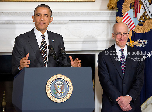 United States President Barack Obama, left, announces his intent to nominate Timothy Massad, right, as Chairman of the Commodity Futures Trading Commission (CFTC) during an event in the State Dining Room of the White House in Washington, D.C. on Tuesday, November 12, 2013.<br /> Credit: Ron Sachs / Pool via CNP