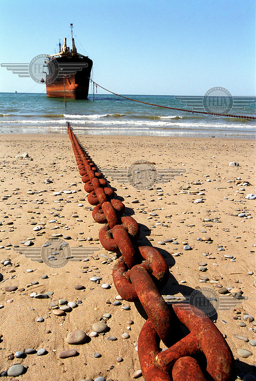 A ship waiting to be dismantled is tethered with heavy chains. In the days when Gaddani ship-breaking yard was still in full operation it wasn't uncommon to find hundreds of ships here, all waiting to be broken up for scrap.