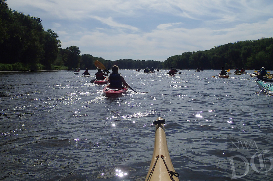 NWA Democrat-Gazette/FLIP PUTTHOFF<br /> The Great River Rumble canoe and kayak trip heads down a backwater of the Mississippi River July 30 2015 during the seven-day trip. The trip covered 106 miles on the Turkey River in northeast Iowa and the Mississippi.