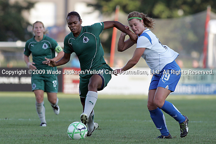 01 Aug 2009: Jennifer Nobis (19) of the Breakers tries to pull Kia McNeill (left) of Saint Louis Athletica off the ball.  Saint Louis Athletica defeated the visiting Boston Breakers 1-0 in a regular season Women's Professional Soccer game at Anheuser-Busch Soccer Park, in Fenton, MO.