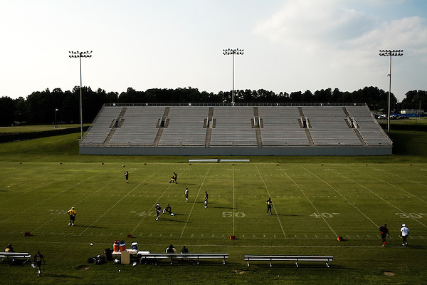 July 26, 2008. Durham, NC.. Local semi-pro football team, the Triangle Rattlers, played the Rowan Rampage in the opening game of the 2008 semi-pro season.. The players are unpaid and the league continues to struggle with financial issues, but many o the players see this as their last shot at a career in football.