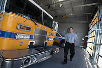 NWA Democrat-Gazette/J.T. WAMPLER Firefighter Jacob Heithoff walks Thursday Aug. 13, 2015 through the engine bay at Fire Station No. 2 at 1660 W. Don Tyson Parkway in Springdale. The station was built using bond money Springdale got between August and September 2012.