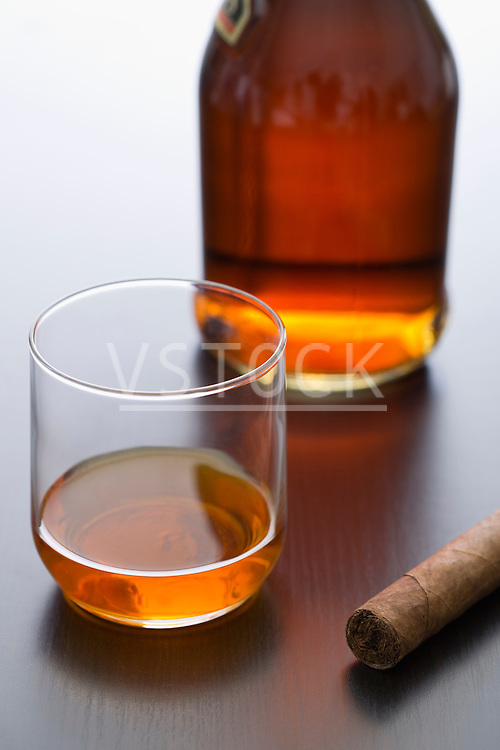 Whiskey and cigar on table