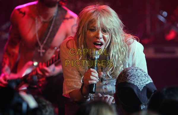 COURTNEY LOVE .Perform at The Camp Freddy South East Asia Tsunami Relief Fund Benefit held at The Key Club in West Hollywood, California .January 27th, 2005.headshot, portrait, microphone, singing, music, stage, gig, concert.www.capitalpictures.com.sales@capitalpictures.com.Supplied By Capital PIctures