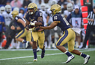 Annapolis, MD - September 8, 2018: Navy Midshipmen quarterback Malcolm Perry (10) hands the ball off to Navy Midshipmen running back CJ Williams (20) during game between Memphis and Navy at  Navy-Marine Corps Memorial Stadium in Annapolis, MD. (Photo by Phillip Peters/Media Images International)