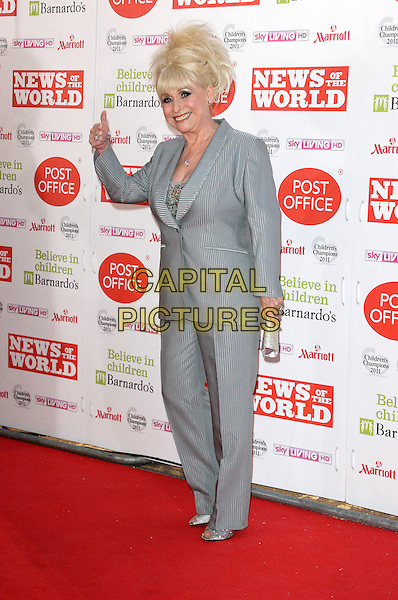BARBARA WINDSOR .Attending the News of the World Children's Champions Awards at the Grosvenor House Hotel, Park Lane, London, England, UK, March 30th 2011..full length grey gray suit trousers jacket gesture   thumb up .CAP/ROS.©Steve Ross/Capital Pictures