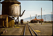 Station at Antonito on right and tank to left with dual trackage in middle.<br /> D&amp;RGW  Antonito, CO  6/29/1965