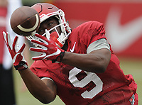 NWA Democrat-Gazette/ANDY SHUPE<br /> Arkansas receiver De'Vion Warren reaches to make a catch Tuesday, Aug. 1, 2017, during practice at the university's practice field in Fayetteville. Visit nwadg.com/photos to see more photographs from the day's practice.