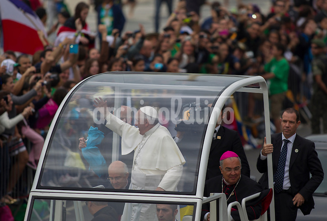 Pope Francisc on board the Papa Mobile great thousands of faifthfull i gathered along Copacabana beach   in  Rio de Janeiro, Brazil