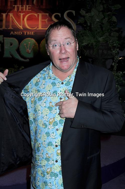 John Lasseter showing his Princess and the Frog shirt