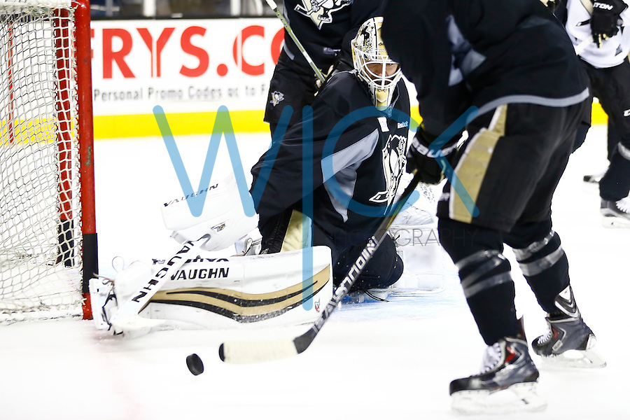 Matt Murray #30 of the Pittsburgh Penguins makes a save during practice at the SAP Center in San Jose, California on June 5, 2016. (Photo by Jared Wickerham / DKPS)