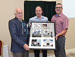 Paul Brennan and Martin O'Brien make a presentation to Paddy Brennan at the official opening of the new Associated Bridge Clubs of Drogheda (ABCD) headquaters on the Fair Green. Photo:Colin Bell/pressphotos.ie
