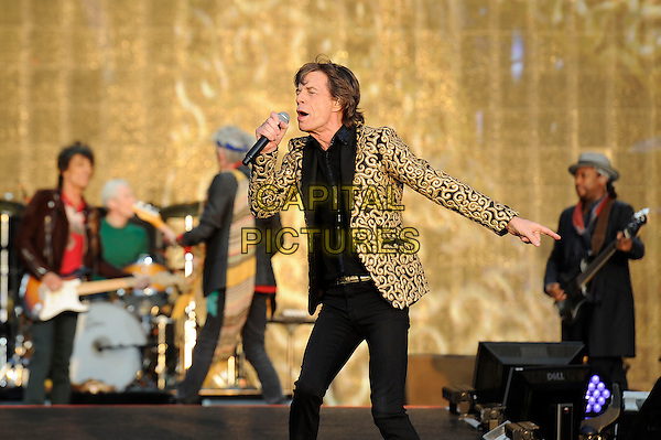 Mick Jagger of The Rolling Stones <br /> performing at Barclaycard British Summertime, Hyde Park, London, England, UK, <br /> 13th July 2013.<br /> music concert gig festival live on stage  half length microphone gold black patterned blazer jacket singing <br /> CAP/MAR<br /> &copy; Martin Harris/Capital Pictures