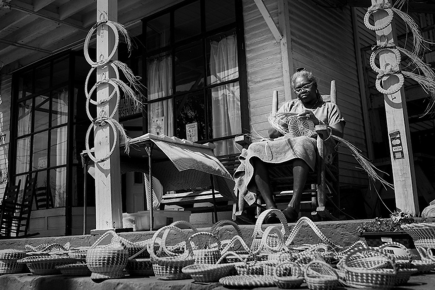 Jery Bennet Taylor sews sweetgrass baskets on the porch at Gullah Grub, a restaurant on St. Helena Island specializing in traditional Gullah food.